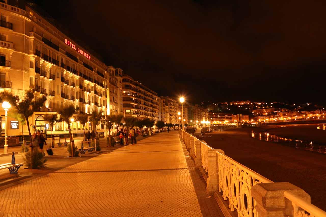 Walking along the quiet pedestrian way alongside Playa de la Concha in Donostia at night
