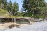Sandcut_Beach_055_08032017 - Looking towards the Sandcut Beach Waterfall from closer to the Strait of Juan de Fuca. Notice the house nestled amidst the trees above the falls as well as the rope swing further to the right of this photo