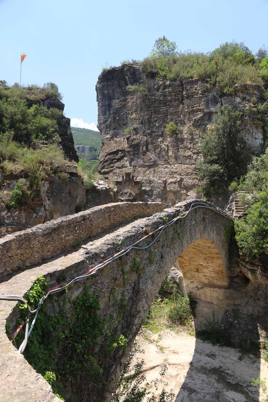 Crossing over a bridge leading towards the entrance of Sant Miquel de Fai