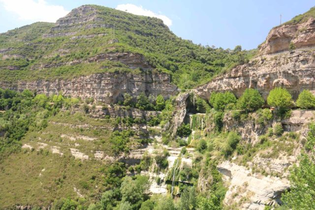 Sant_Miquel_de_Fai_026_06202015 - Context of the full height of Salt de Tenes as seen from the walkway towards the entrance of the Monastery of Sant Miquel del Fai