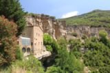 Sant_Miquel_de_Fai_115_06202015 - Looking back along the cliffs where you can see that some of the buildings of the Sant Miquel del Fai complex were actually built atop cliff overhangs!