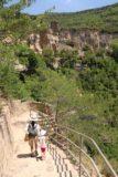 Sant_Miquel_de_Fai_119_06202015 - Julie and Tahia descending some steps towards the Cueva de Sant Miquel