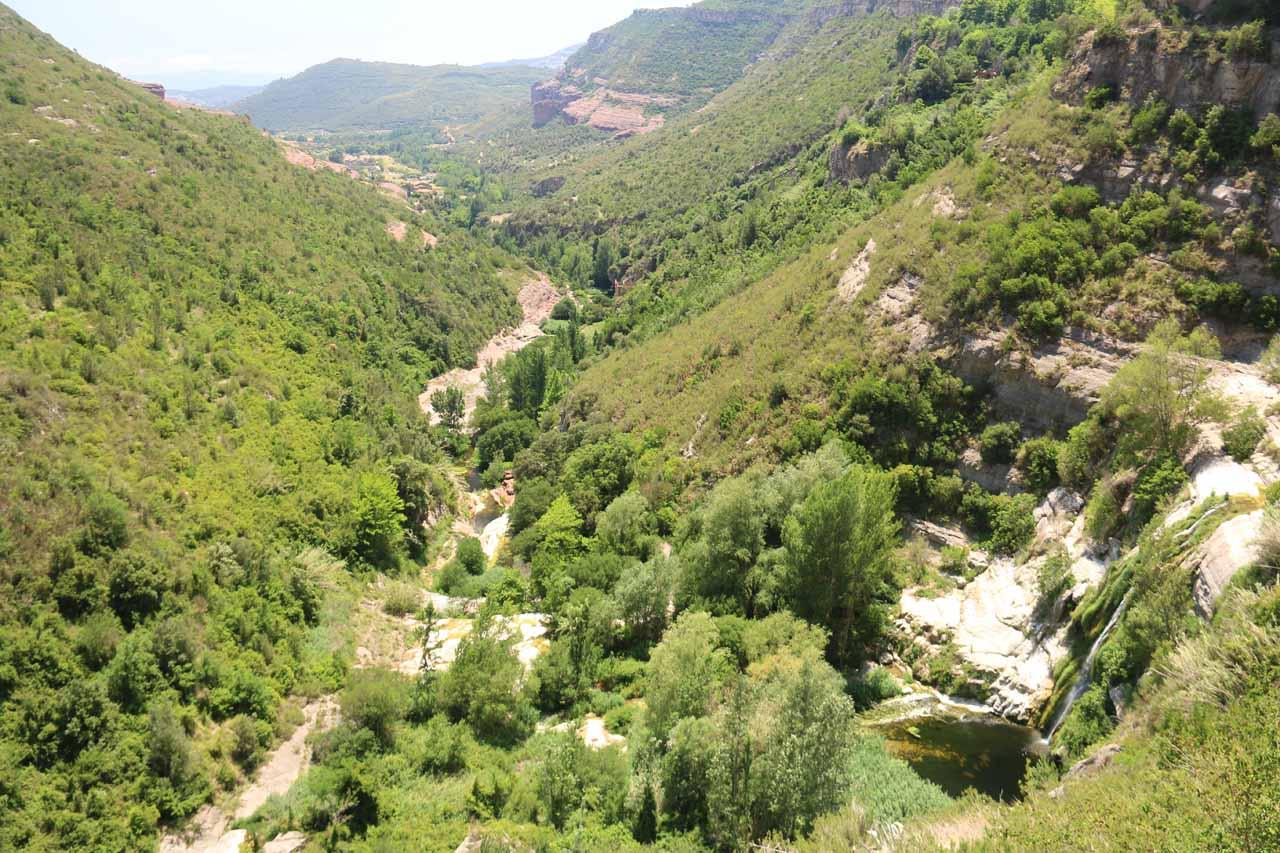 Looking past the base of Salt de Tenes towards the Val de Tenes from the steps leading to the entrance of Cueva de Sant Miquel