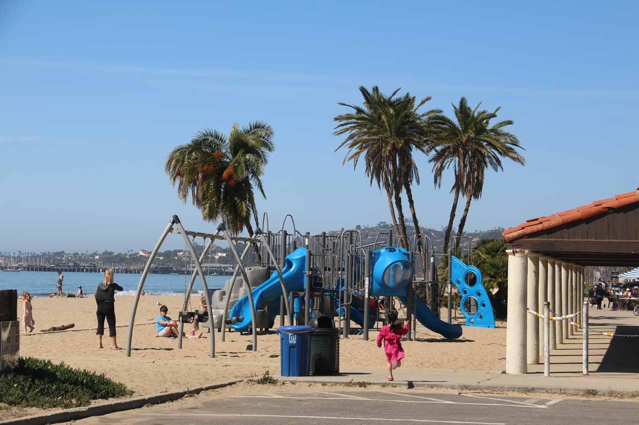 Tahia running towards the playground on the beach right across from the Hyatt Centric