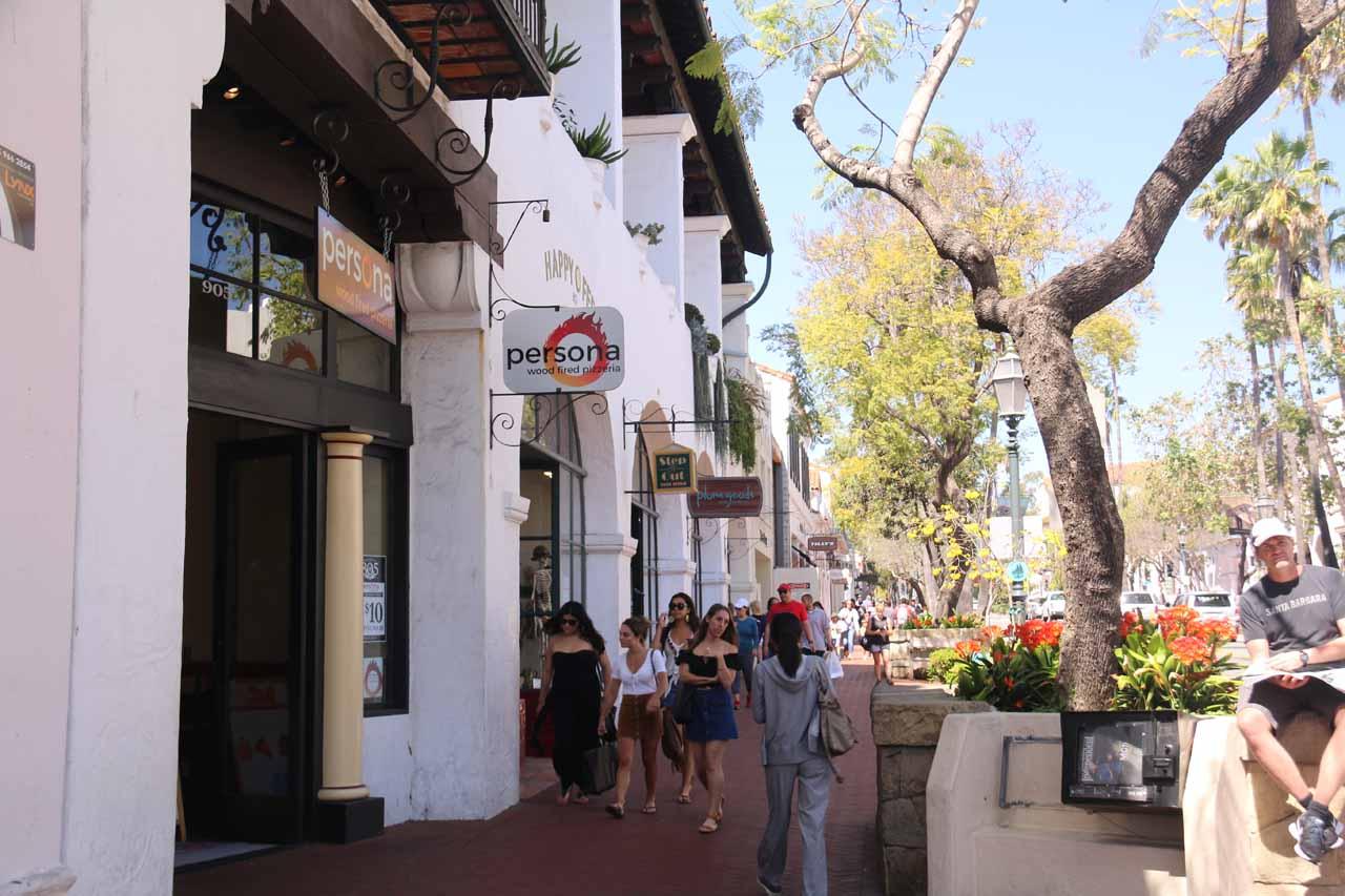 Julie walking along State Street in downtown Santa Barbara