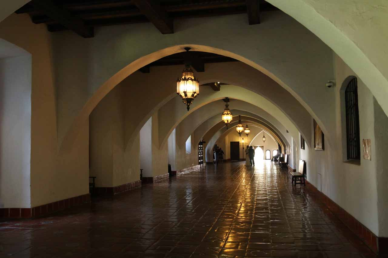 Looking down an arched corridor in the Santa Barbara Courthouse