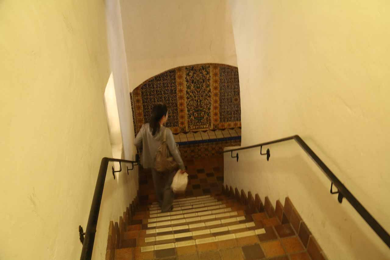 Julie taking the stairs to go down to the lower floors of the Santa Barbara Courthouse