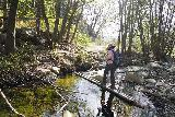 Santa_Paula_Canyon_372_03052021 - Mom going across Santa Paula Creek near the trio of oil-drilling grasshoppers