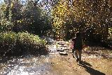 Santa_Ynez_Falls_187_01192019 - Tahia and Julie going back across the first stream crossing with the circular concrete steps to make this slippery traverse a lot easier as we were nearing the end of our Santa Ynez Falls adventure
