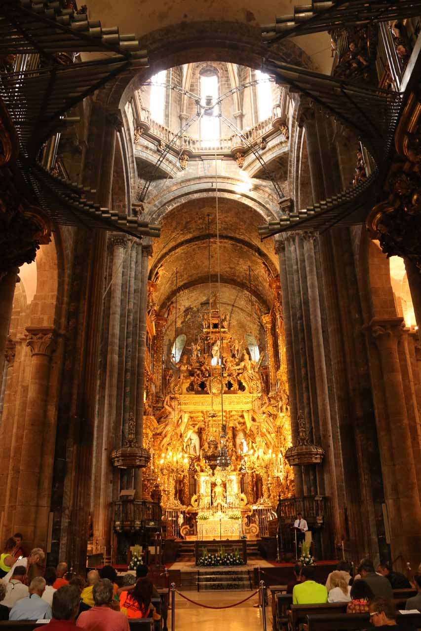 Inside the Catedral de Santiago de Compostela with some huge botafumeiro hanging in front of the main altar