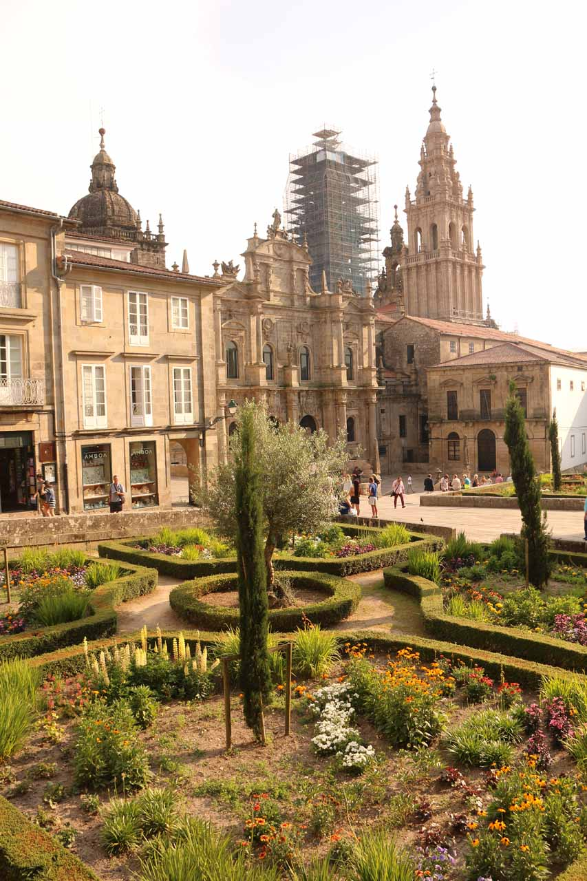 Looking over a garden towards the scaffolded Catedral de Santiago de Compostela at the Praza da Inmaculada