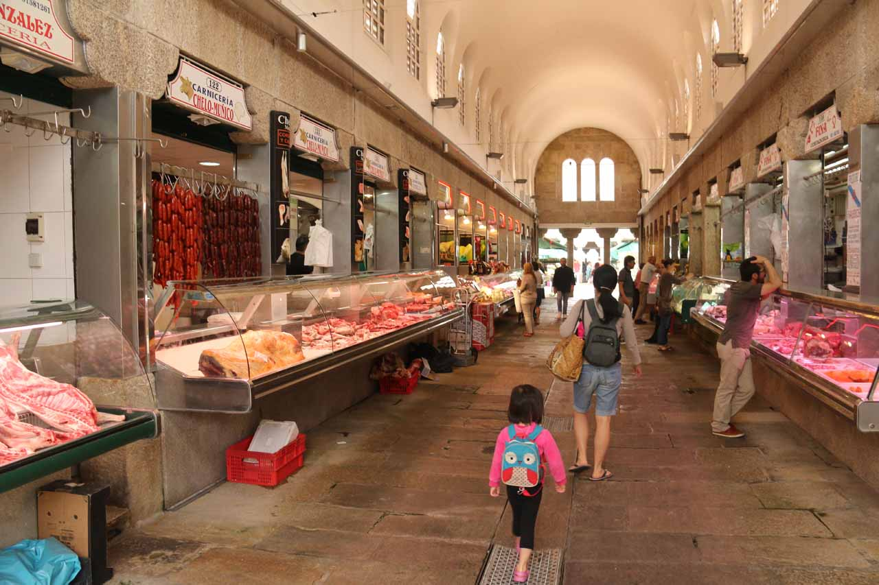 Inside one of the fish market aisles of the Mercado de Abastos