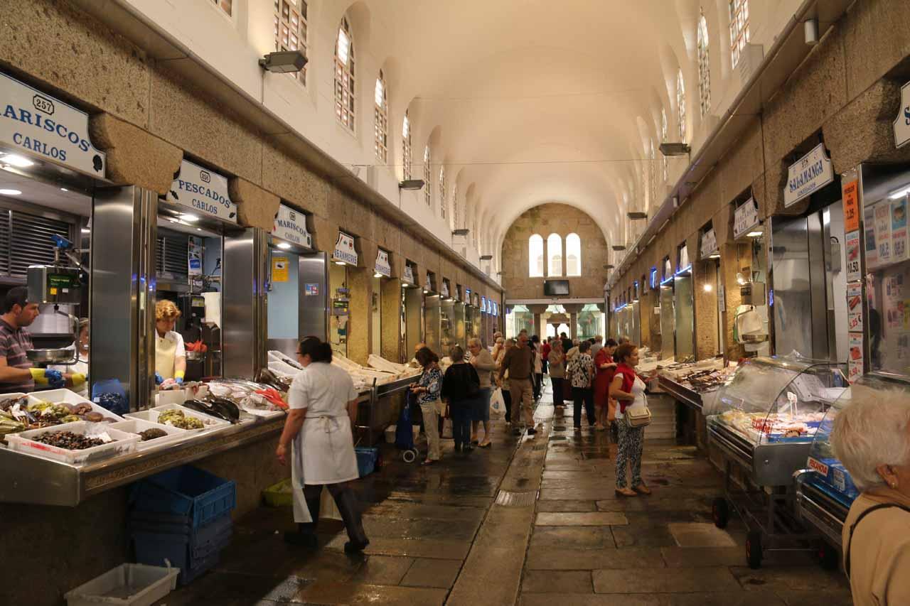 Checking out another fish market aisle within the Mercado de Abastos