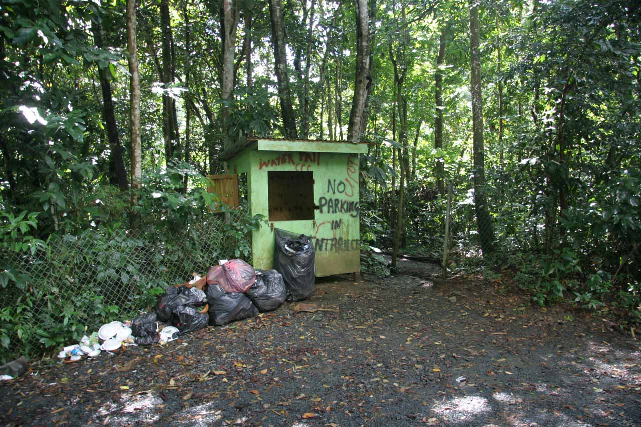 The shack surrounded by trash marking trailhead