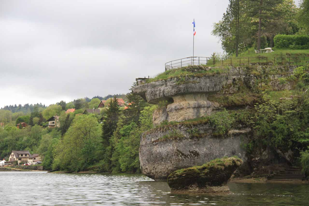 A prominent-looking rock with the French and Euro flags on it