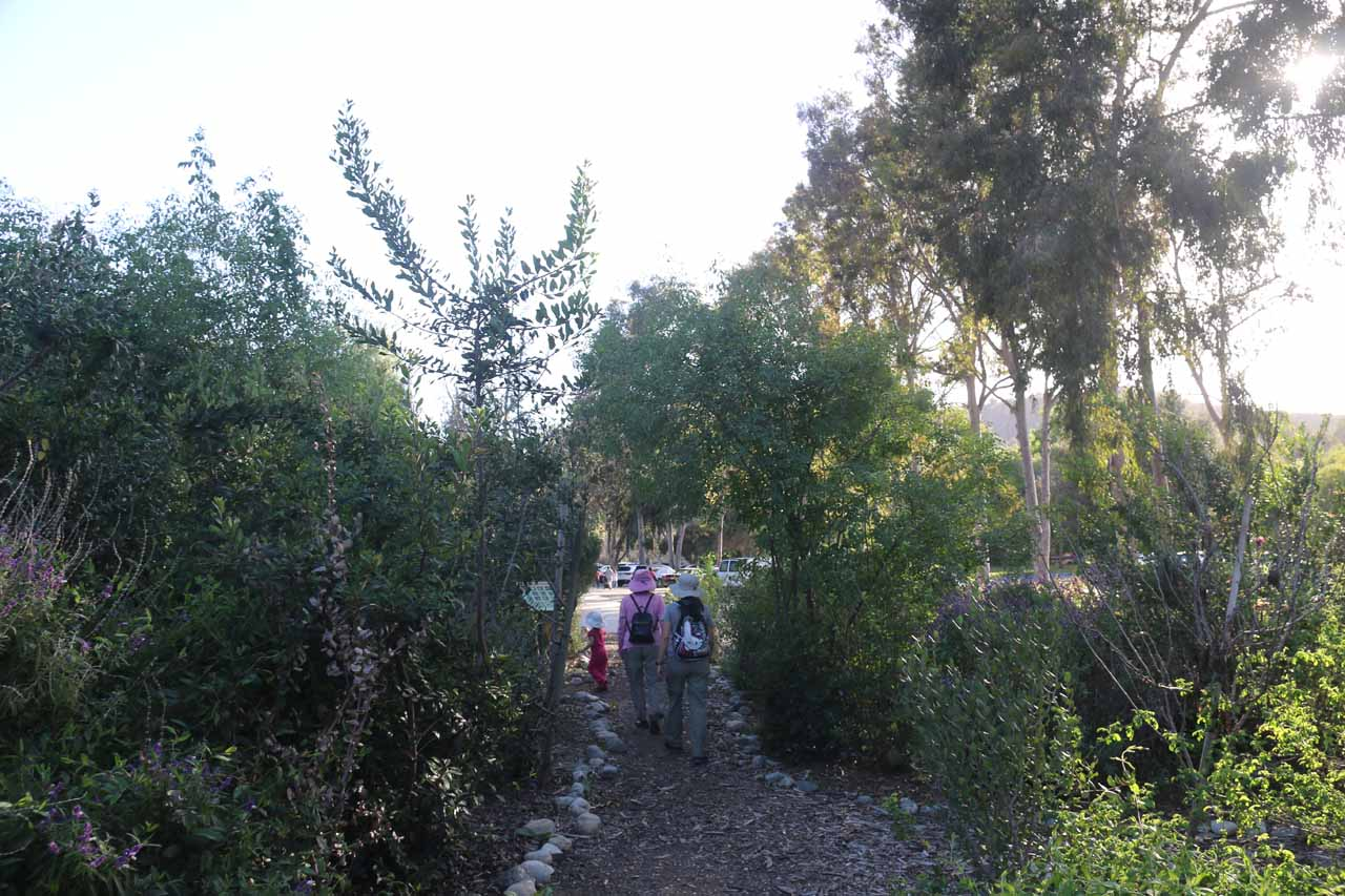The family walking through a garden in Schabarum Park