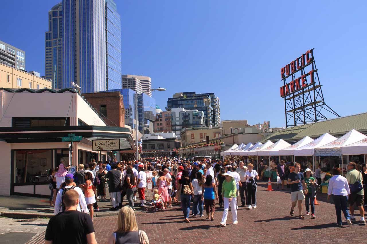 The Bainbridge Island Ferry to Olympic Peninsula departed from the Seattle waterfront, which included Pike's Market as shown here