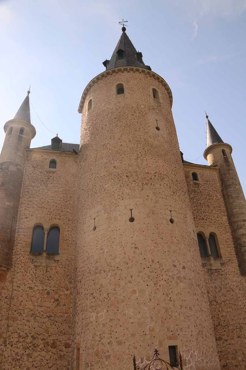 Looking up at a trio of turreted towers of the Alcazar de Segovia