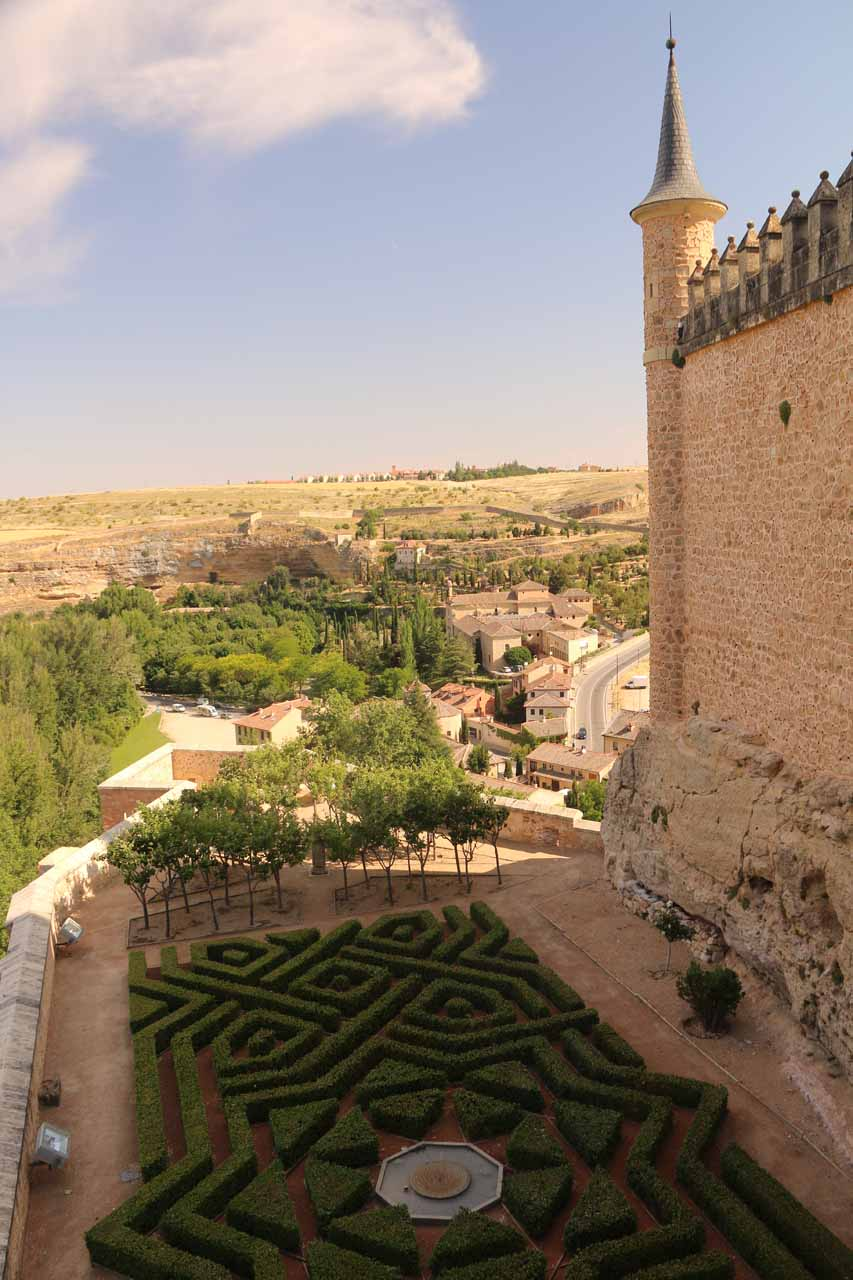 Looking down at some kind of garden maze on the shadowed side of the Alcazar de Segovia
