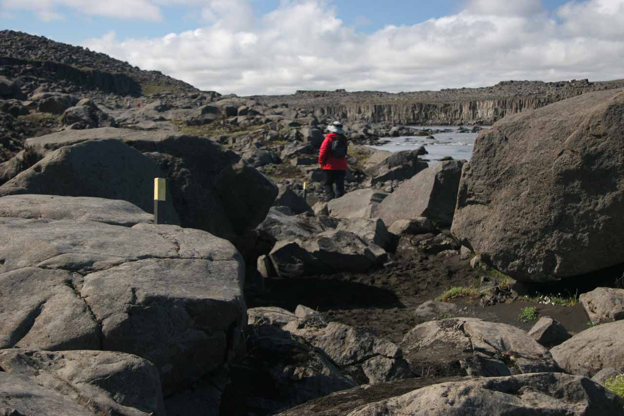 Julie navigating through the boulder field trying to follow the trail markers