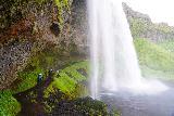Seljalandsfoss_and-Gljufrabui_041_08072021 - Looking back at the context of the backside of Seljalandsfoss and the waterfall itself