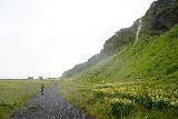 Seljalandsfoss_and-Gljufrabui_048_08072021 - Mom going on the trail going past some of the side waterfalls on the way to Gljufrabui