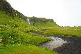 Seljalandsfoss_and-Gljufrabui_087_08072021 - Looking back at the context of Seljalandsfoss and a companion waterfall fronting it