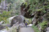 Senga_Falls_074_10172016 - Mom walking beneath an overhanging rock within the Shosenkyo Gorge