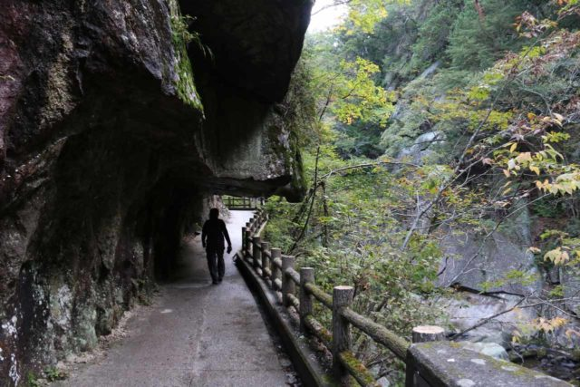 Senga_Falls_082_10172016 - Context of Mom walking back through the overhangs within the Shosenkyo Gorge as we were making our return hike