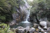 Senga_Falls_083_10172016 - Contextual view of the boulder-fringed plunge pool before the Sengataki Waterfall