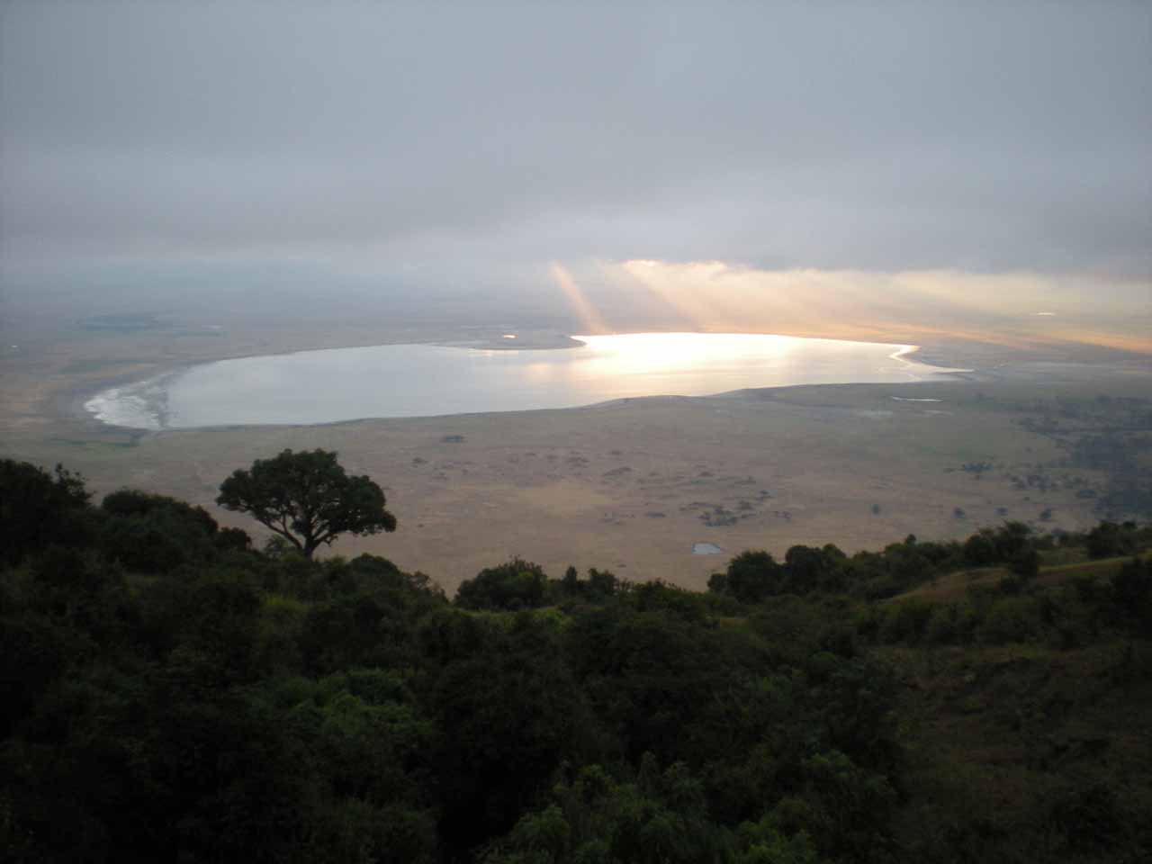 Contextual view of sun beams on the Ngorongoro Crater