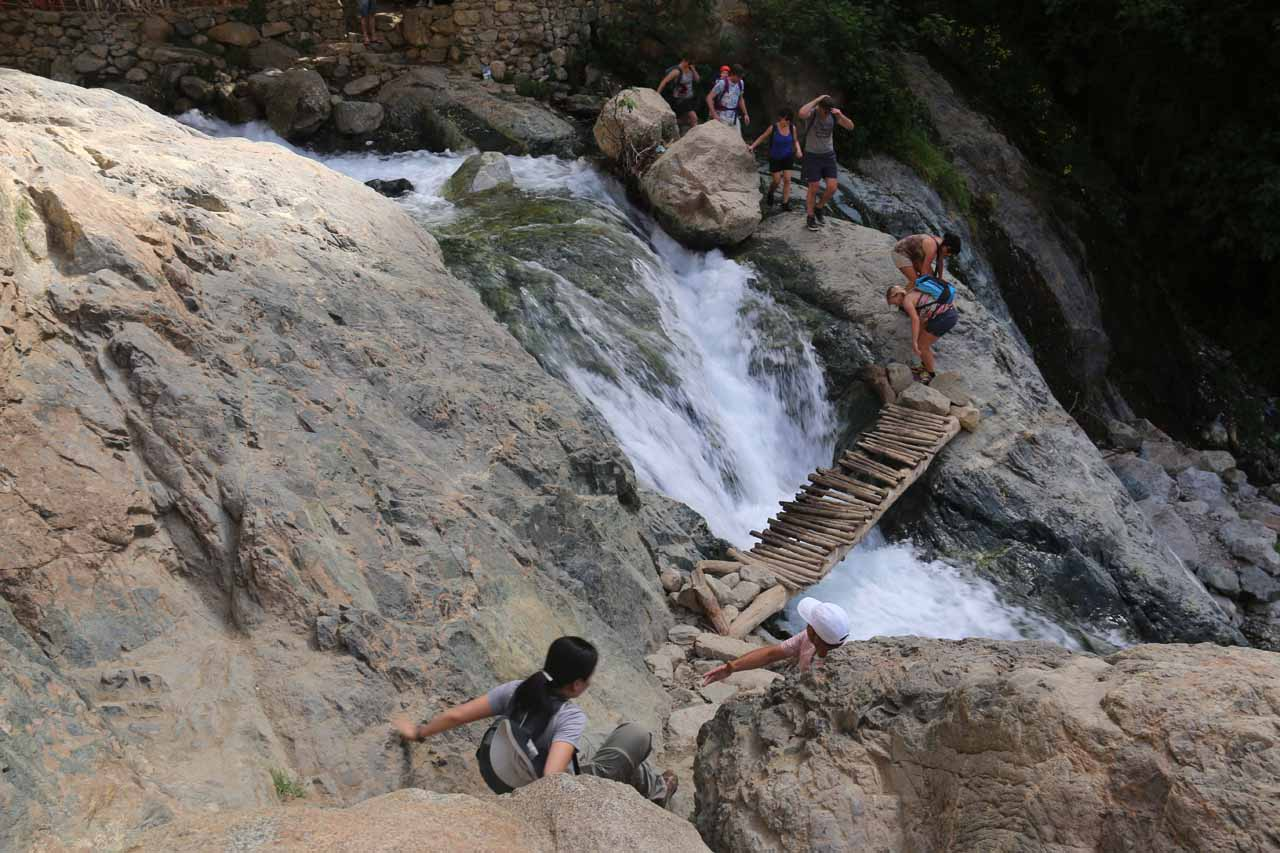 Julie descending towards the final footbridge before the cafe and the first Setti Fatma Waterfall