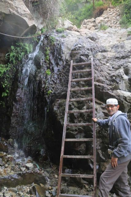 Setti_Fatma_102_05162015 - A local guide sets up a temporary ladder to traverse a very steep and harrowing climb above the first of the Setti Fatma Waterfalls