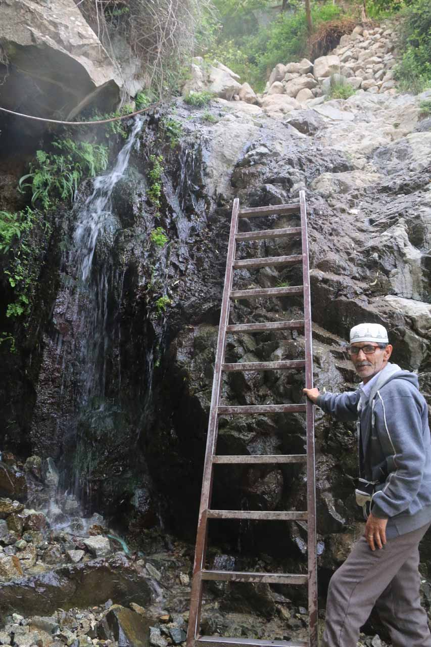 This Berber local sets up and guards this ladder to continue hiking further up in exchange for a baksheesh (Arabic for 'tip')