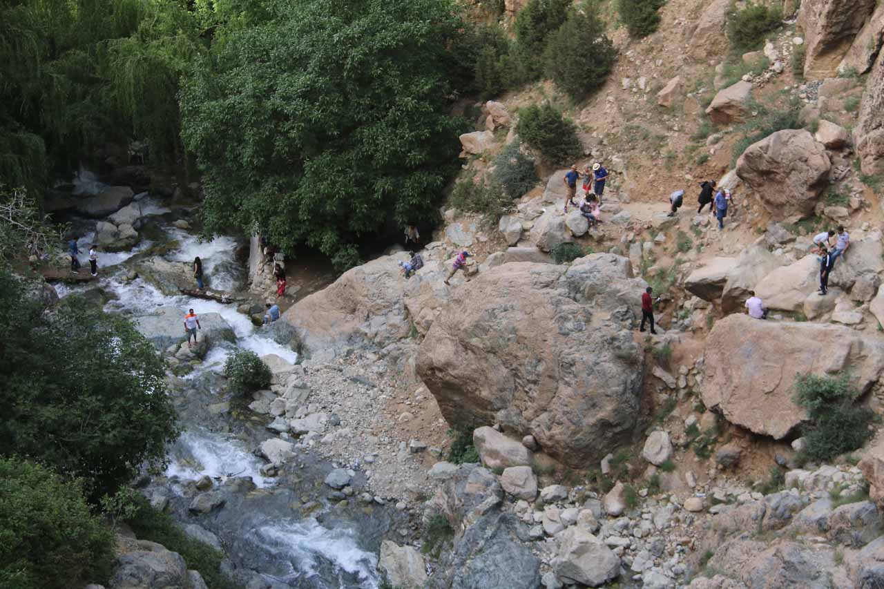 Looking down at the context of other hikers making their way along the rocky path
