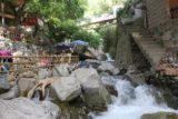 Setti_Fatma_206_05162015 - Looking back at the stream weaving between a pair of cafes and over some small cascades in Setti Fatma village