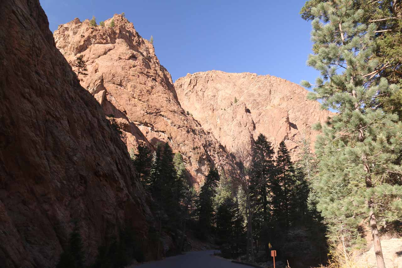 Looking back at the cliffs towering above the paved shuttle road in South Cheyenne Canyon