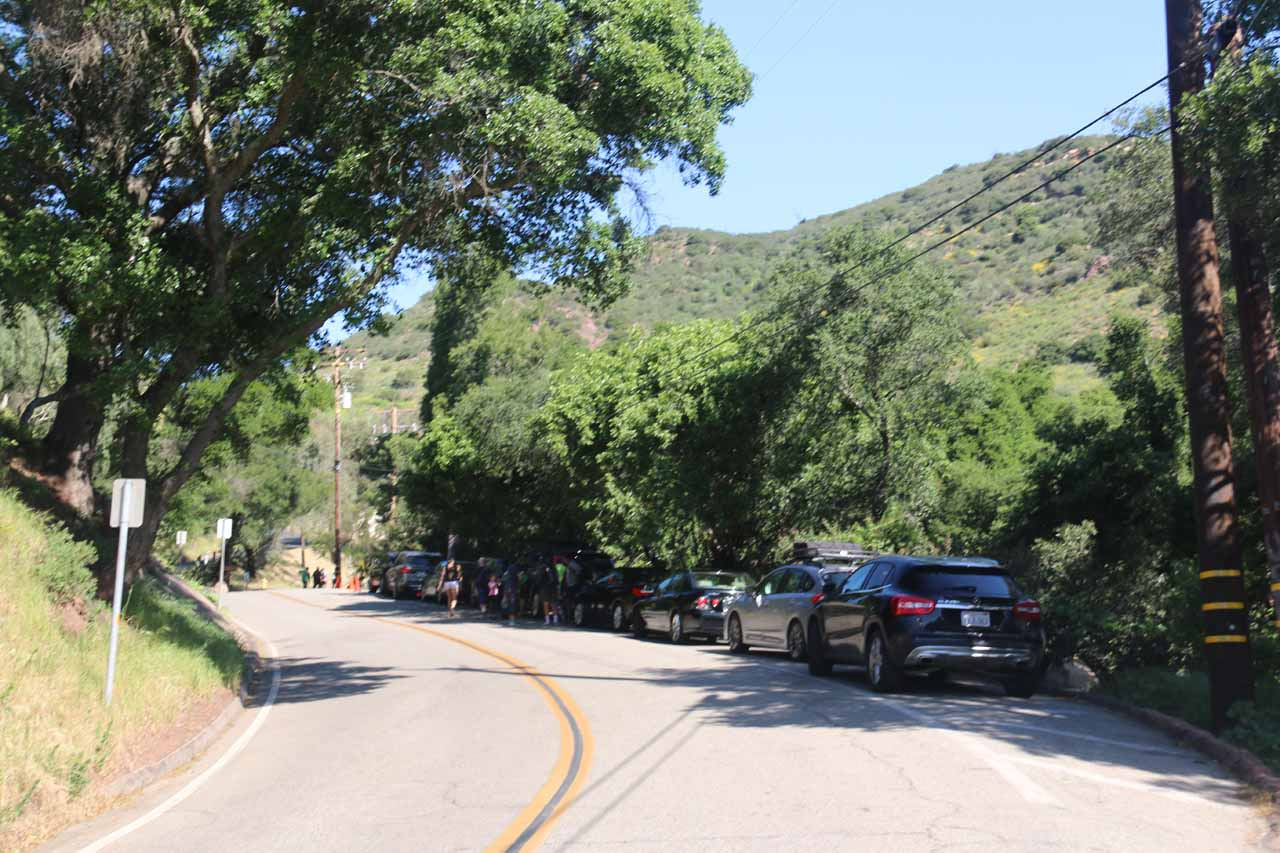 Looking back at the cars parked in the closest spots to the Tunnel Trailhead