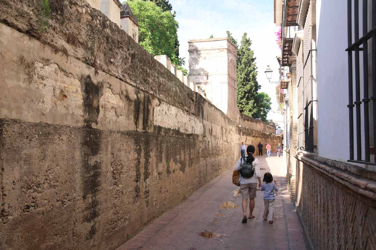 Tahia and Julie walking alongside the garden walls as we went searching for the entrance to the Real Alcazar