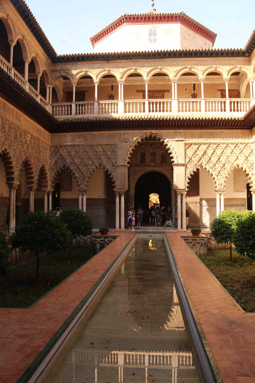 Reflections and ornate arches at this courtyard in the Real Alcazar de Sevilla