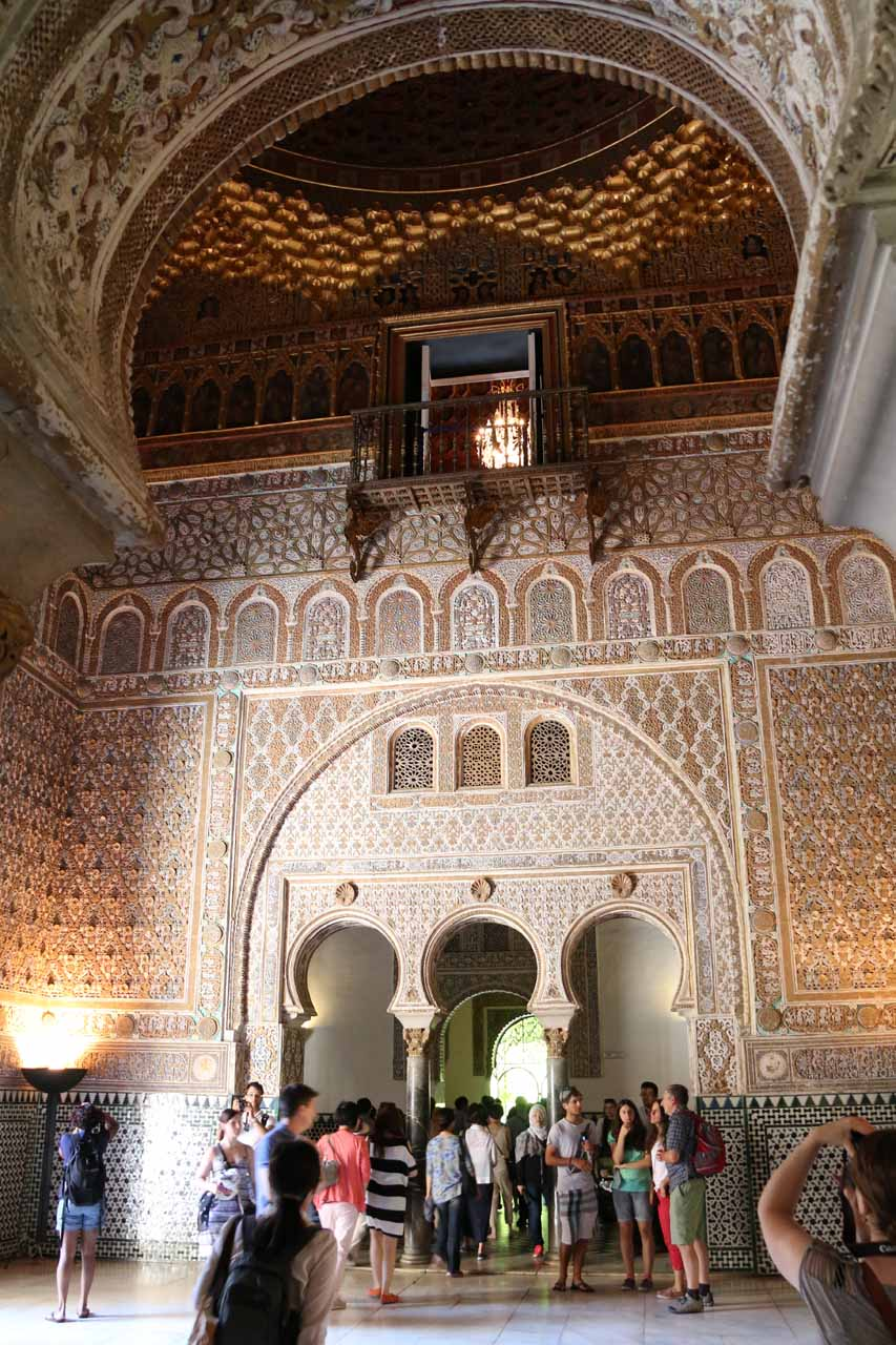 Inside a very ornate and tall room within the Real Alcazar de Seviila