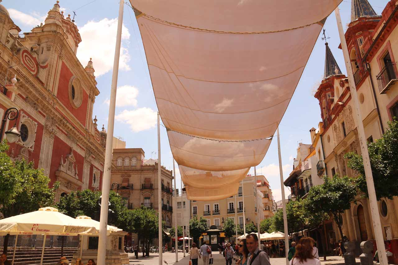 Walking beneath a shelter as we passed through Plaza del Salvador