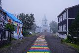Seydisfjordur_017_08092021 - Another colorful look back at the church in Seydisfjordur with the rainbow path appearing to lead right to it