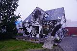 Seydisfjordur_022_08092021 - Looking at the decorated house next door to the Kaffi Lara El Grillo Bar in Seydisfjordur