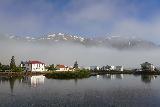 Seydisfjordur_047_08102021 - Broad look across the harbor towards the lifting fog, the increasing blue skies, and the buildings across the way in Seydisfjordur