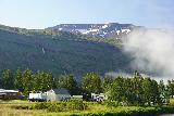 Seydisfjordur_063_08102021 - This was a morning view in August 2021 of a cascade on Hádegisá as seen from the main part of Seyðisfjörður
