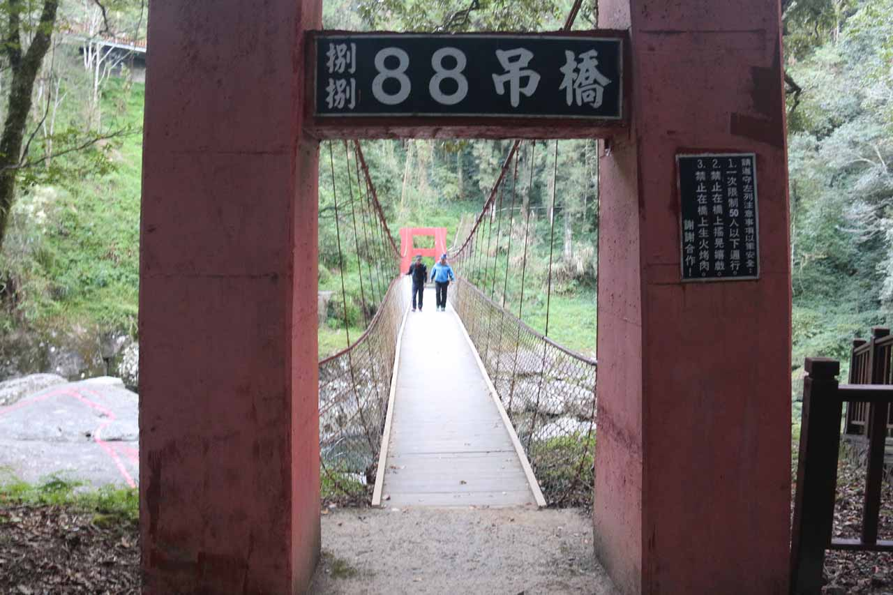 Crossing over the suspension bridge with 88 written on it