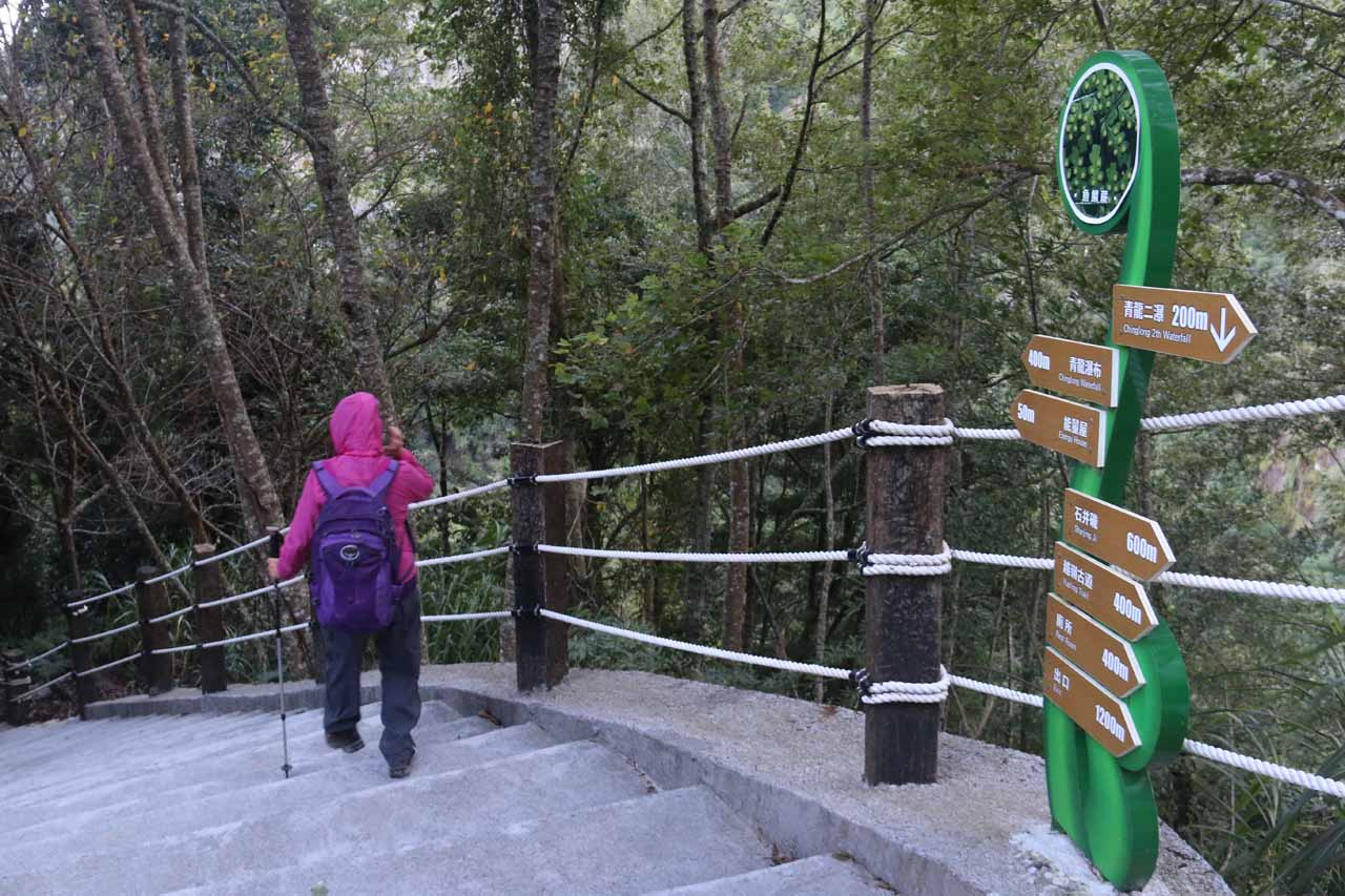Mom hiking down the trail for the bottom of the Chinglong Falls
