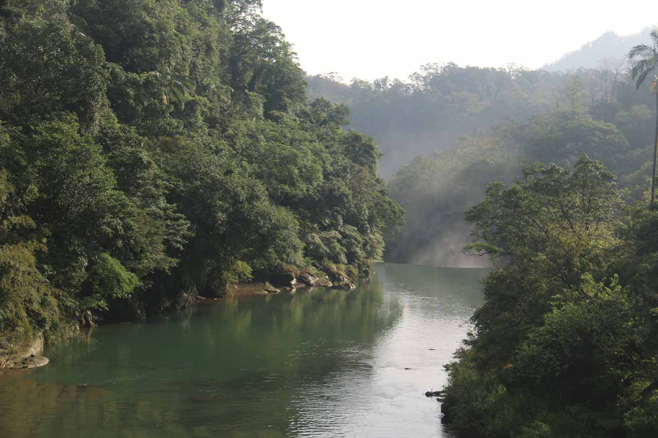 While crossing the suspension bridge, we noticed wafting mist rising further downstream on the Keelung River, which we knew had to have come from the Shifen Waterfall