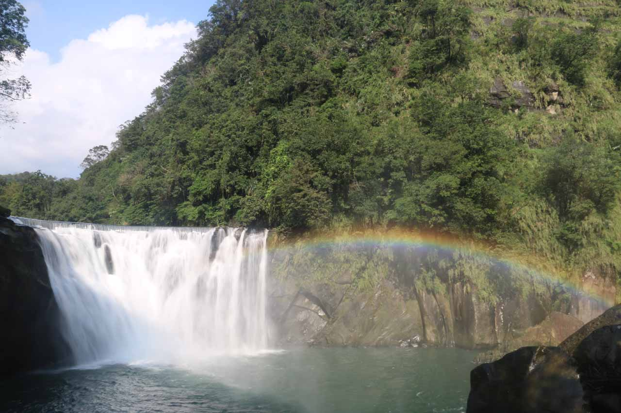 The Shifen Waterfall with a bold rainbow